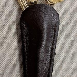 Gold-scissors-in-sheath