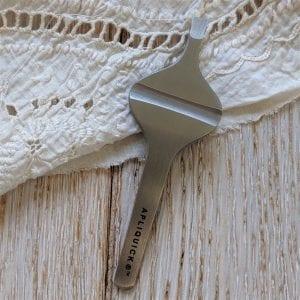 Apliquick tweezers styled shot